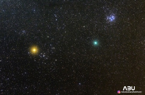 Comet 4P/Wirtanen (green fuzzy object) in Taurus with Pleiades and Aldebran. A self-portrait with the COMET 46P (greenish object besides star cluster)