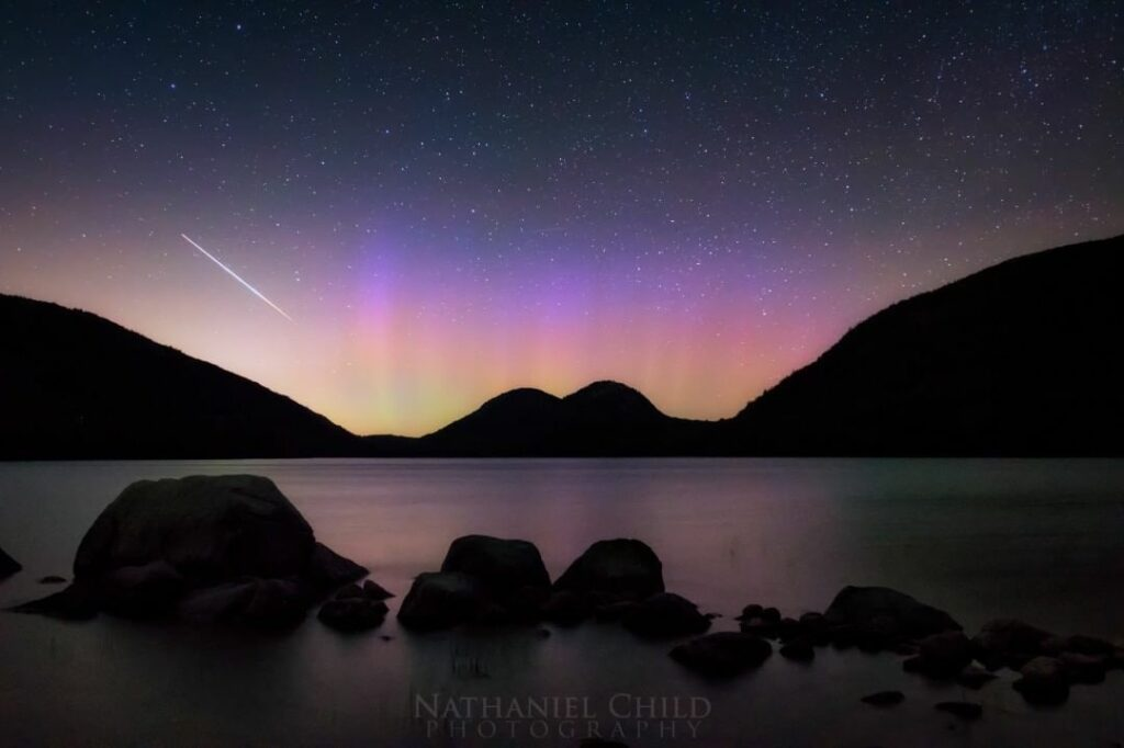 Northern lights at Acadia National Park beautifully complement this image of the alpha capricornids meteor shower