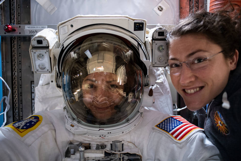 Astronauts Jessica Meir and Christina Koch preparing on the ISS for the first all-female spacewalk
